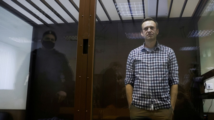 FILE PHOTO: FILE PHOTO: Russian opposition leader Alexei Navalny attends a court hearing in Moscow, Russia February 20, 2021…