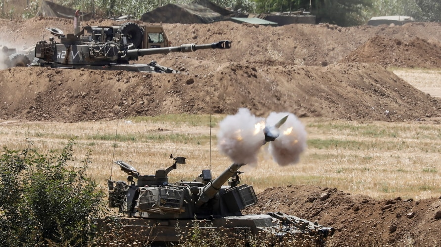 An Israeli military artillery unit fires a shell, as seen from the Israeli side of the border with the Gaza Strip May 16, 2021…