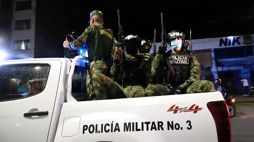"""Members of security forces patrol in Cali as President Ivan Duque ordered """"the maximum deployment"""" of military personnel to…"""