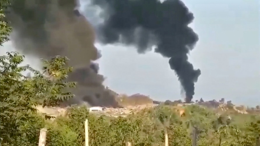 Thick columns of black smoke are seen from Hkamti, Sagaing, Myanmar May 22, 2021 in this picture obtained from social media…