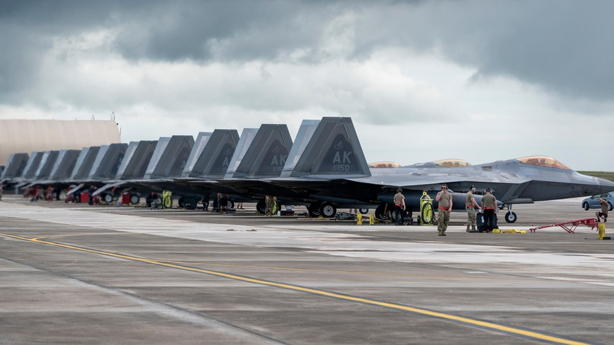 U.S. Air Force F-22 Raptors assigned to the 199th Fighter Squadron, 154th Wing, Joint Base Pearl Harbor Hickam, Hawaii and the…