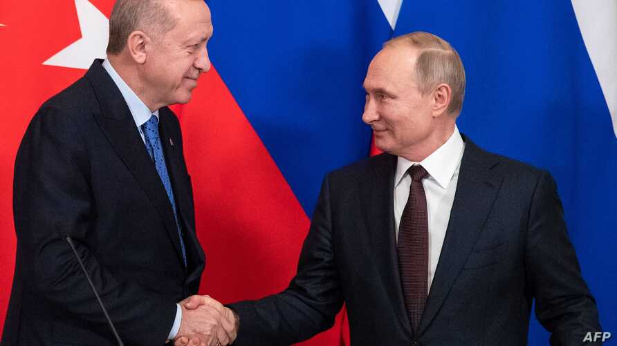 Russian President Vladimir Putin and his Turkish counterpart Recep Tayyip Erdogan shake hands at the end of a joint press…