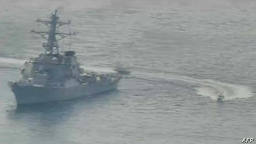 (FILES)This US Navy file photo shows Iranian Islamic Revolutionary Guard Corps Navy (IRGCN) vessels conducting unsafe and…