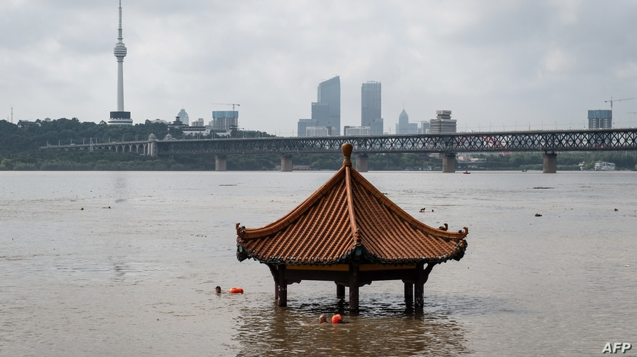 This photo taken on July 6, 2020 shows a pavilion partially submerged in flood waters on the banks of the Yangtze River after…