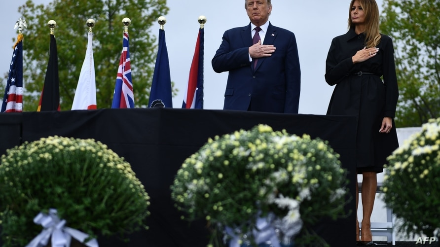US President Donald Trump and First Lady Melania Trump attend a ceremony commemorating the 19th anniversary of the 9/11 attacks…
