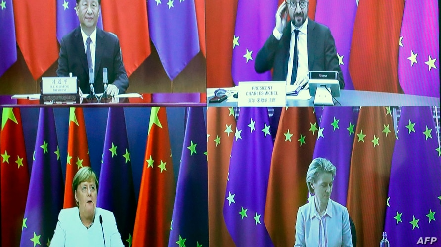 TOPSHOT - Chinese President  Xi Jinping (top L), European Council President Charles Michel (top R), European Commission…