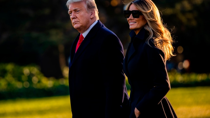 President Donald Trump and First Lady Melania Trump walk towards Marine One as they depart the White House en route to Mar-a…