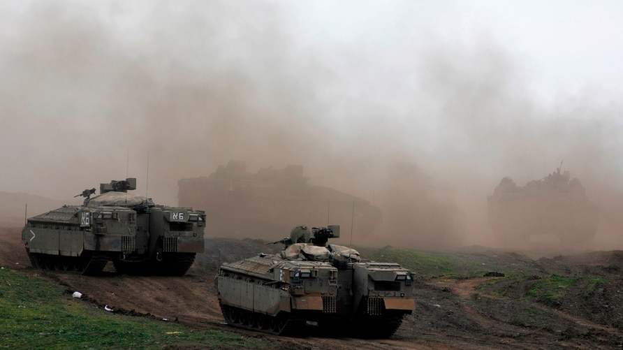 Israeli troops are pictured during a military drill in the Israeli-annexed Golan Heights on January 13, 2021. - Israeli night…