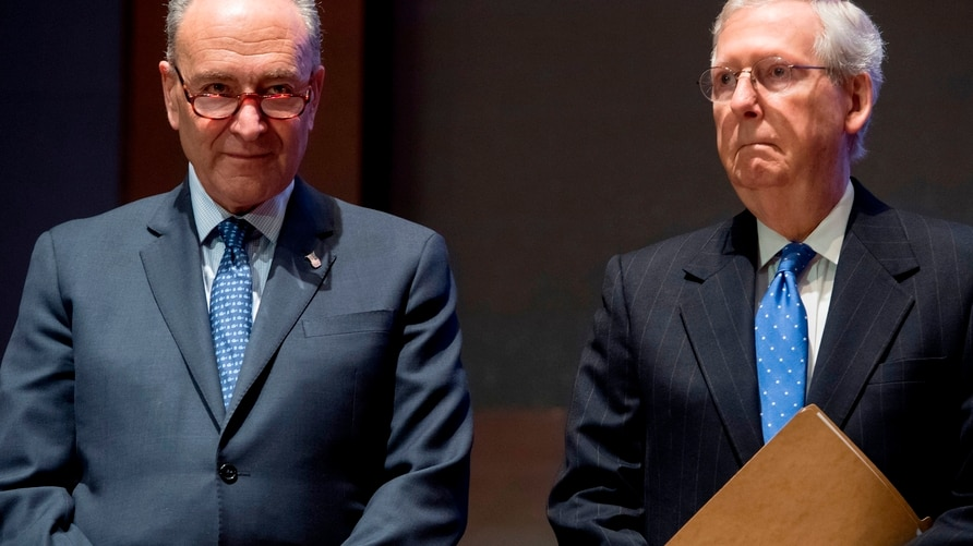 (FILES) In this file photo taken on November 9, 2017 US Senate Majority Leader Mitch McConnell (R) and US Senate Minority…