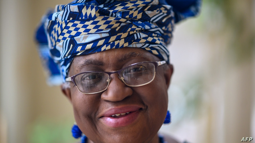Nigeria's Ngozi Okonjo-Iweala poses at her home in Potomac, Maryland, near Washington DC, minutes before she was confirmed as…