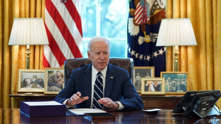US President Joe Biden signs the American Rescue Plan on March 11, 2021, in the Oval Office of the White House in Washington,…