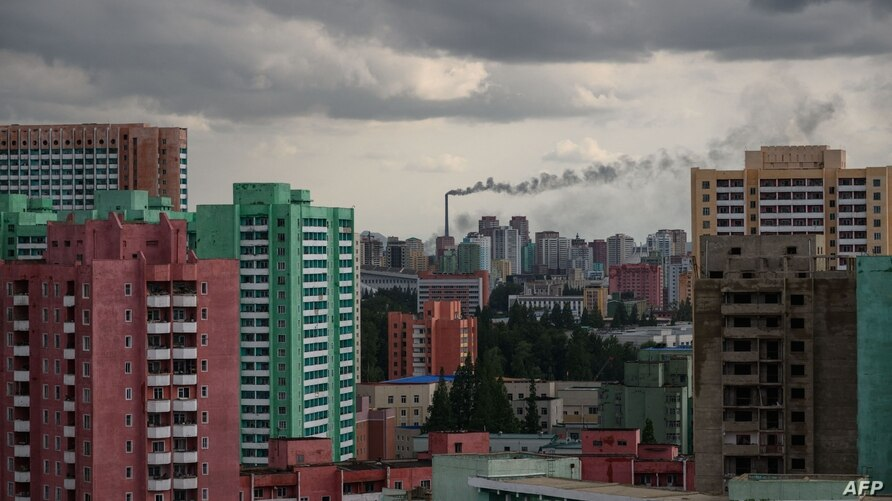 (FILES) This file photo taken on June 15, 2018 shows smoke billowing from a chimney in Pyongyang. - North Korea used South…