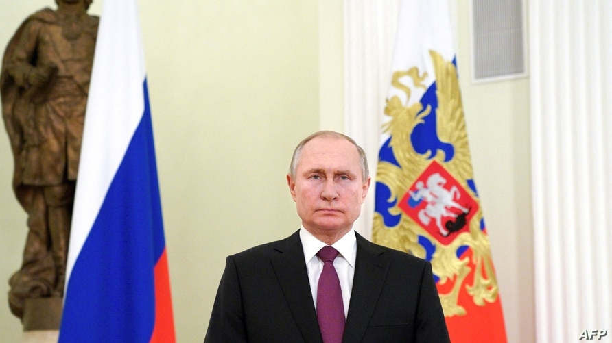 Russian President Vladimir Putin addresses on the occasion of the Day of the National Guard Troops, in Moscow, on March 27,…