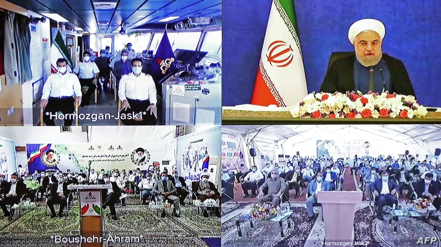 This handout photograph released by the Iranian President's Office on July 22, 2021, showsIranian President Hassan Rouhani …