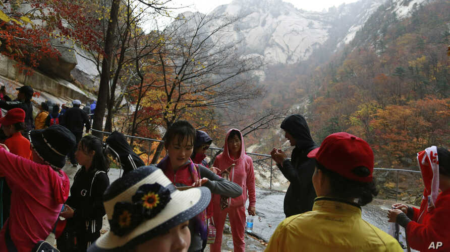 FILE - In this Oct. 23, 2018, file photo, tourists visit Mount Kumgang in North Korea. U.S. President Donald Trump and North…