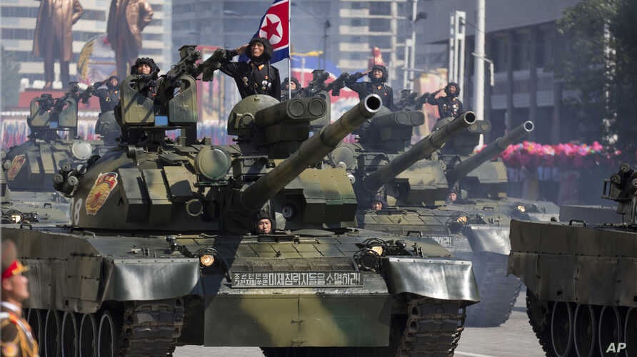 Tanks roll past during a parade for the 70th anniversary of North Korea's founding day in Pyongyang, North Korea, Sunday, Sept…