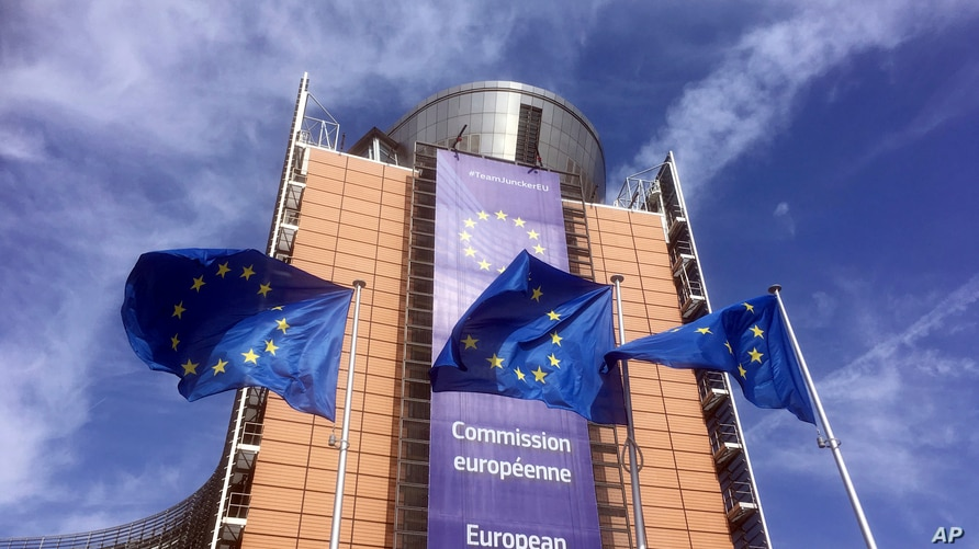 European Union flags flap in the wind outside EU headquarters in Brussels, Wednesday, April 10, 2019. European Union leaders…