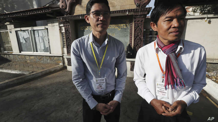 Journalists Uon Chhin, right, and Yeang Sothearin gather in front of the Appeals Court in Phnom Penh, Cambodia, Tuesday, Jan…