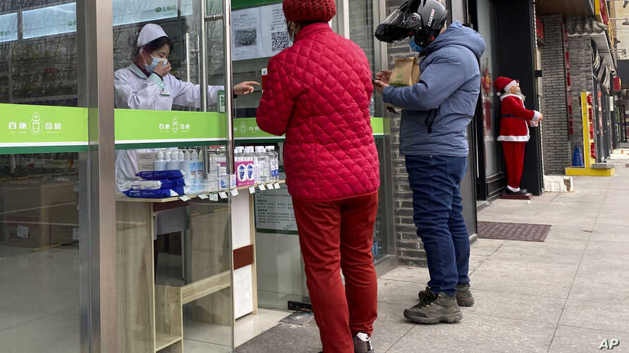 Residents visit a pharmacy in Beijing, China on Thursday, Feb. 20, 2020. A viral outbreak that began in China has infected more…