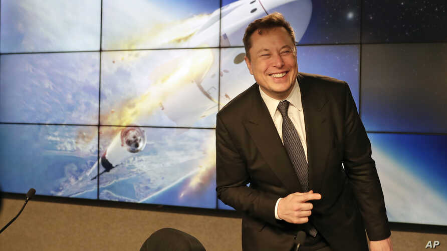 FILE - In this Jan. 19, 2020, file photo Elon Musk, founder, CEO, and chief engineer/designer of SpaceX speaks during a news…