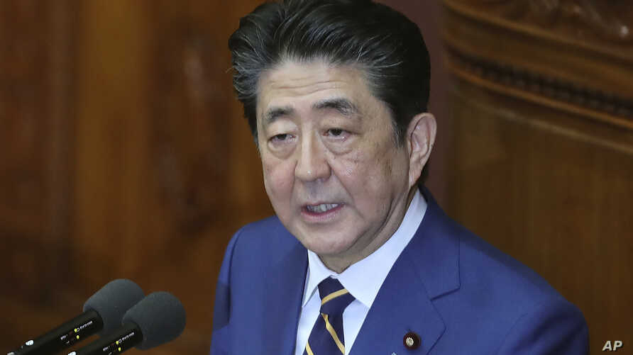 Japanese Prime Minister Shinzo Abe delivers a policy speech in Tokyo, Monday, Jan. 20, 2020. Abe said Monday that Japan will…