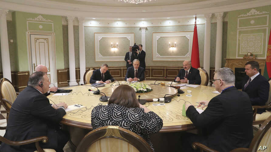Belarusian President Alexander Lukashenko, background second right, and U.S. Secretary of State Mike Pompeo, left, attend the…