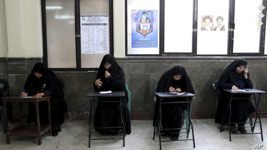 Voters fill out their ballots in the parliamentary elections in a polling station in Tehran, Iran, Friday, Feb. 21, 2020…