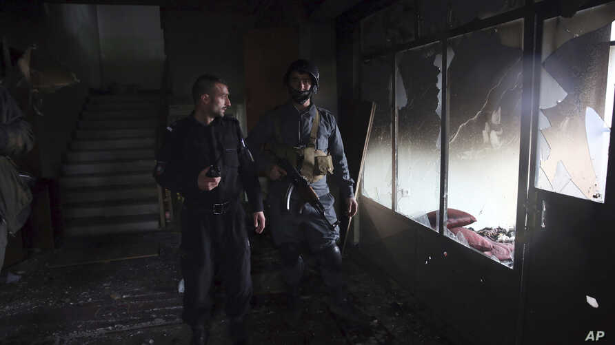 Afghan security personnel inspect a Sikh house of worship, in the aftermath of a deadly attack in Kabul, Afghanistan, Wednesday…