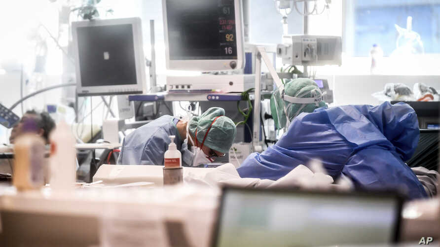 Medical personnel at work in the intensive care unit of the hospital of Brescia, Italy, Thursday, March 19, 2020. Italy has…