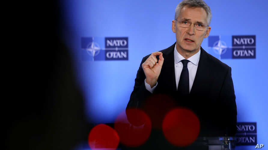 NATO Secretary-General Jens Stoltenberg speaks during a media conference at NATO headquarters in Brussels, Friday, Feb. 28,…