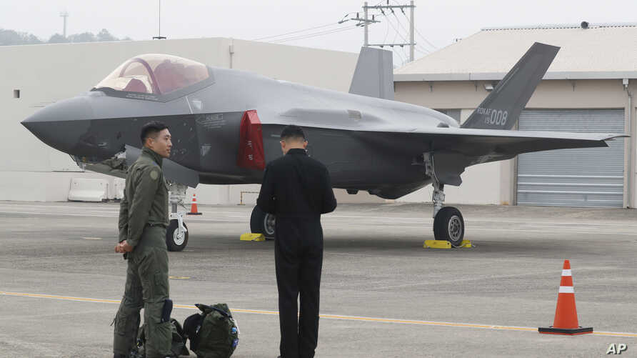 A South Korean fighter pilot, left, stands near F-35 A Stealth in the 71st anniversary of Armed Forces Day at the Air Force…