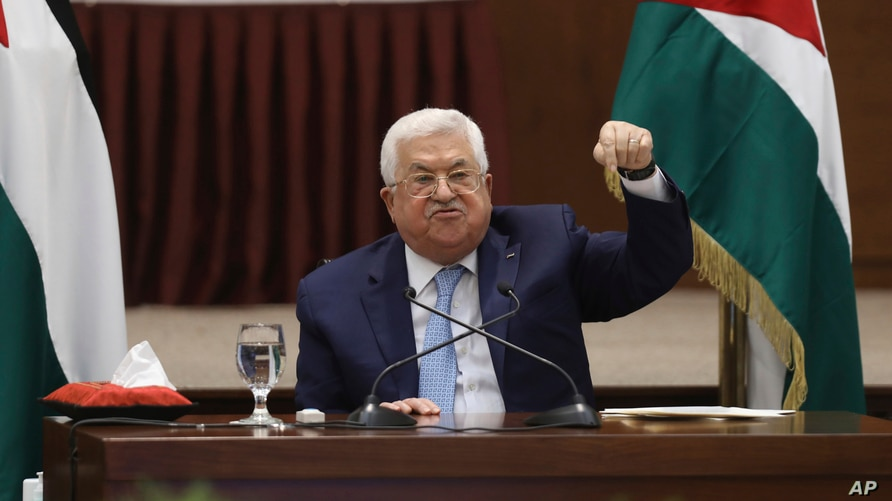Palestinian President Mahmoud Abbas heads a leadership meeting at his headquarters, in the West Bank city of Ramallah, Tuesday,…