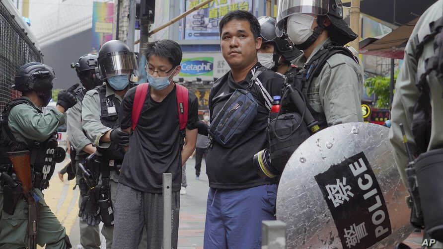 Riot police detain protesters during a demonstration against Beijing's national security legislation in Causeway Bay in Hong…