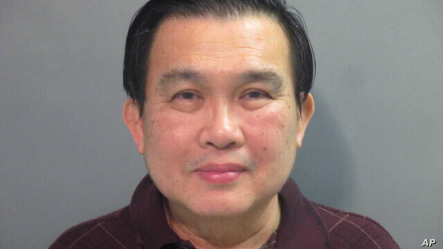 A photo provided by the Washington County (Ark.) Detention Center shows Simon S. Ang, 63. The University of Arkansas has…