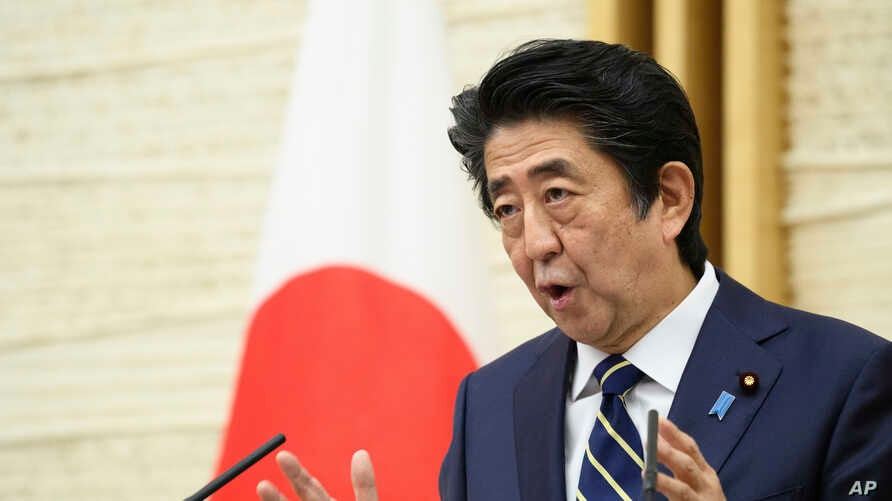 Japanese Prime Minister Shinzo Abe gestures while speaking during a press conference at his official residence in Tokyo…