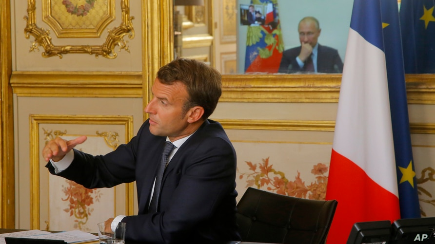 French President Emmanuel Macron talks to Russian President Vladimir Putin during a video conference Friday, June 26, 2020 at…