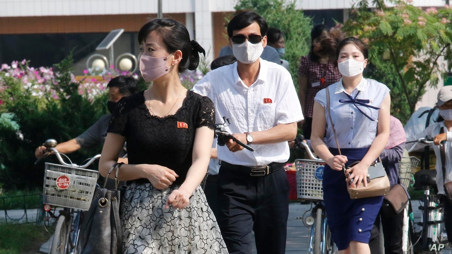 People wearing masks walk in the Ryomyong street in Pyongyang, North Korea Friday, July 3, 2020. North Korean leader Kim Jong…