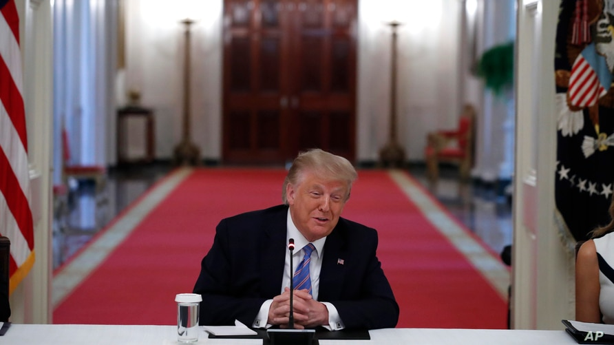 """President Donald Trump speaks during a """"National Dialogue on Safely Reopening America's Schools,"""" event in the East Room of the…"""