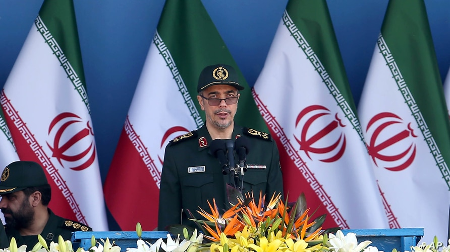 Chief of the General Staff of Iran's Armed Forces, General Mohammad Hossein Bagheri delivers a speech during a military parade…