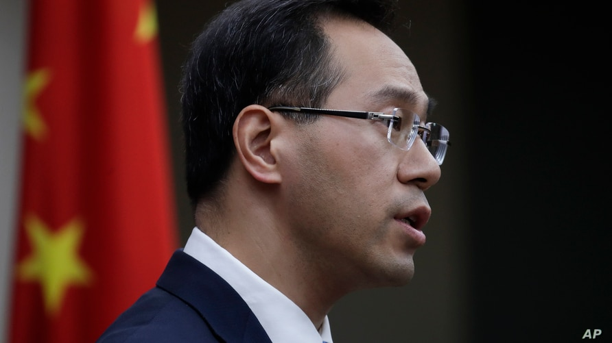 Chinese Ministry of Commerce spokesman Gao Feng speaks during a press conference at the Ministry of Commerce in Beijing, Friday…