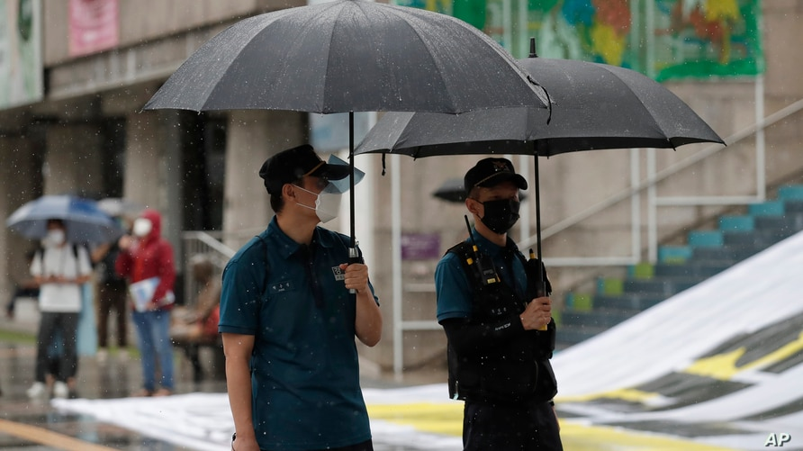 Police officers wear face masks to help protect against the spread of the coronavirus in downtown, South Korea, Wednesday, Sept…