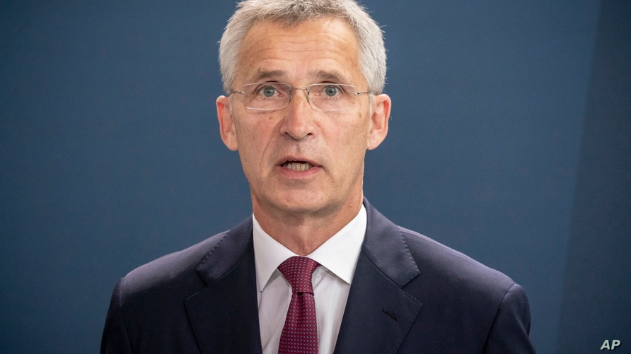 NATO Secretary General Jens Stoltenberg talks to the media after a meeting with German Chancellor Angela Merkel in the…