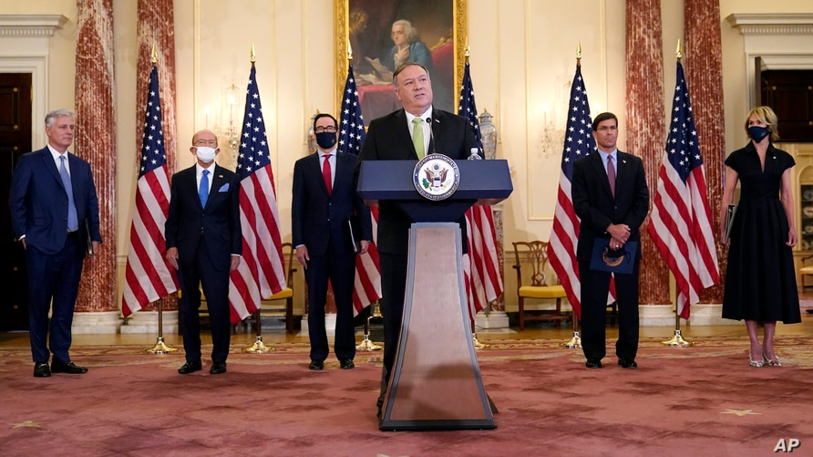 Secretary of State Mike Pompeo speaks during a news conference to announce the Trump administration's restoration of sanctions…