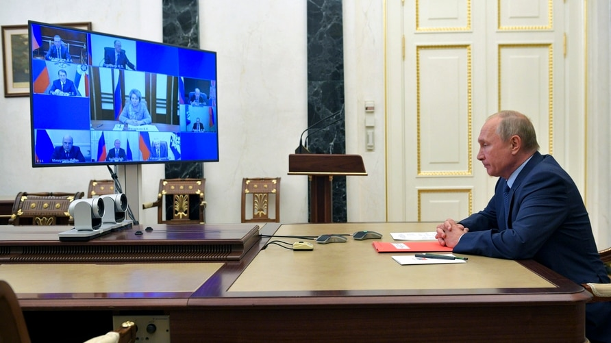 Russian President Vladimir Putin chairs a Security Council meeting via video conference in Moscow, Russia, Friday, Oct. 16,…
