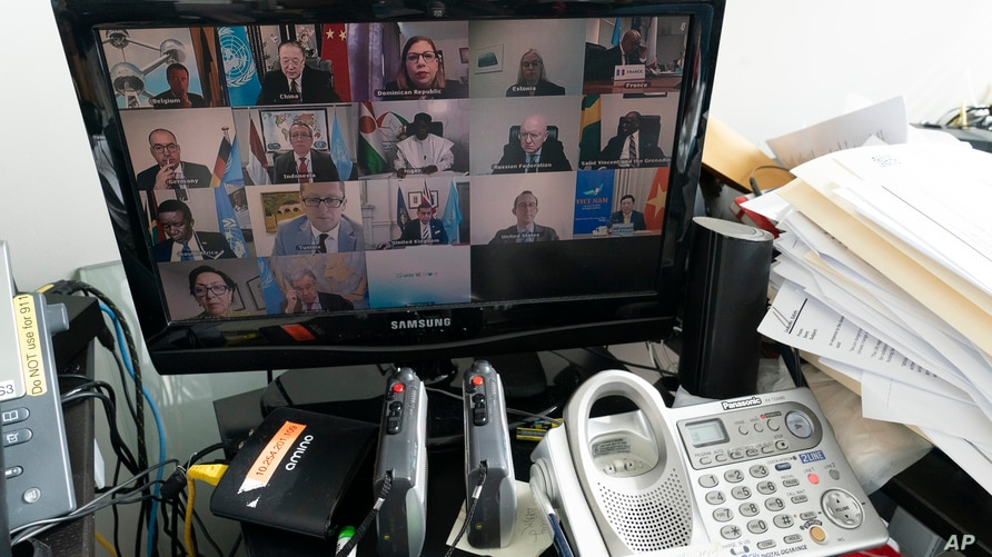 United Nations Secretary-General Antonio Guterres, second from right bottom, seen on a computer monitor at United Nations…