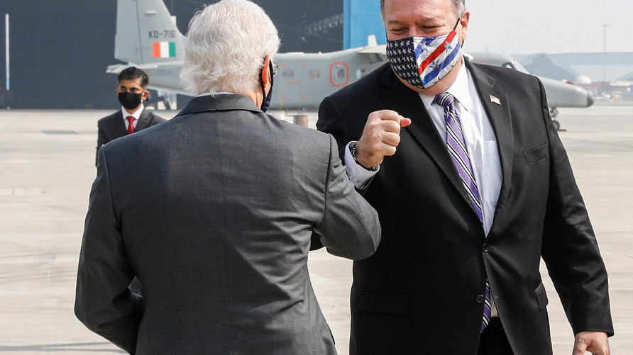 Secretary of State Mike Pompeo and U.S. Ambassador to India Kenneth Juster greet each other upon Pompeo's arrival at the…