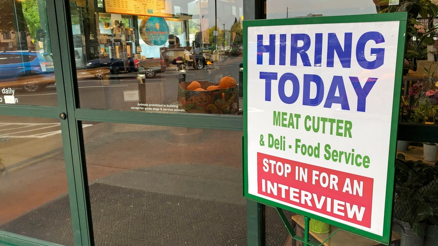 "A sign that reads ""hiring today,"" is shown at a grocery store in Olympia, Wash., advertising a job opportunity for a meat…"