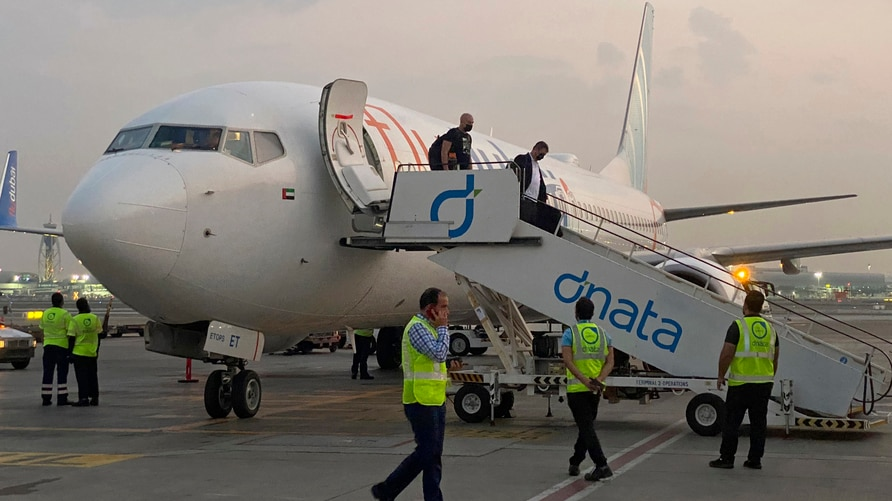 Israeli tourists leave a flydubai plane which departed from Ben-Gurion International Airport in Tel Aviv and landed in Dubai,…