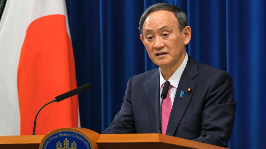 Japan's Prime Minister Yoshihide Suga delivers a speech during a press conference on the latest COVID-19 situation in Japan at…
