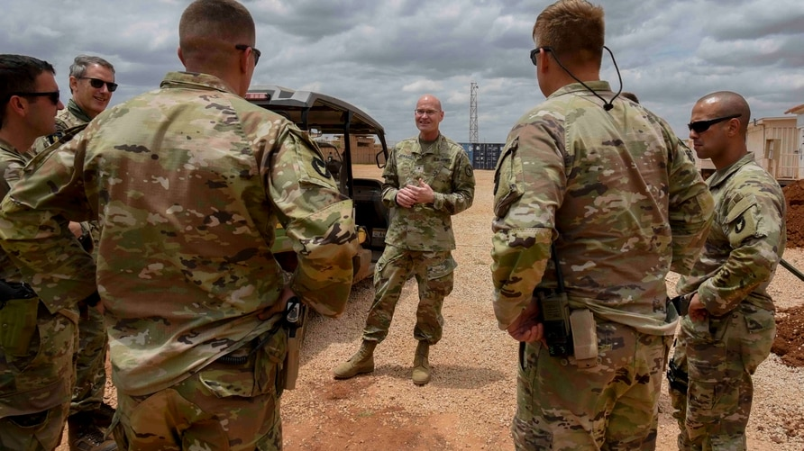 U.S. Army Brig. Gen. Damian T. Donahoe, deputy commanding general, Combined Joint Task Force - Horn of Africa, center, talks…